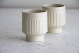 Modern ceramic espresso cup in white