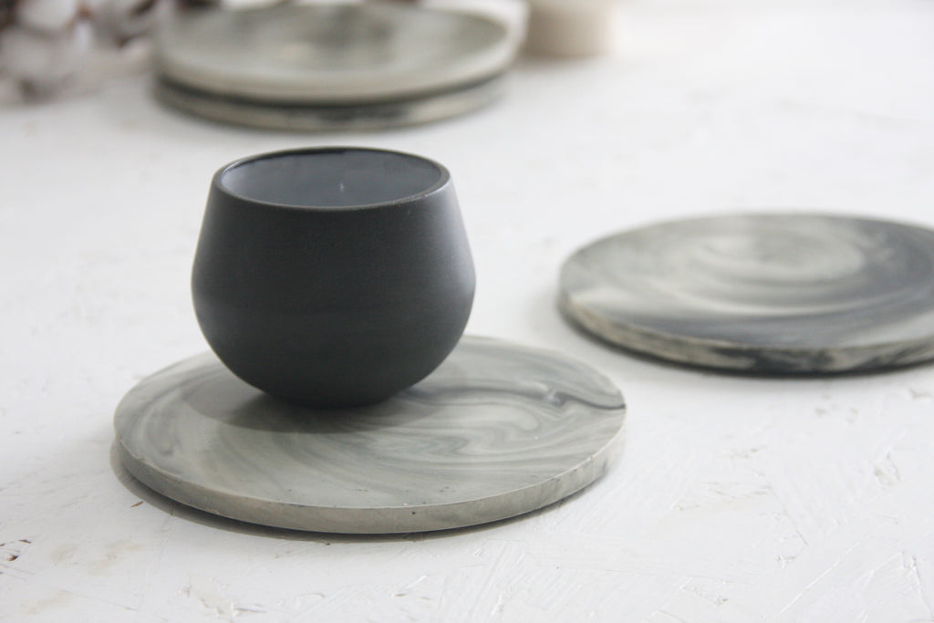 Ceramic espresso cup in black with saucer in black and white marble