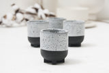 Plus - Ceramic espresso cup in black with white glaze and black dots- short