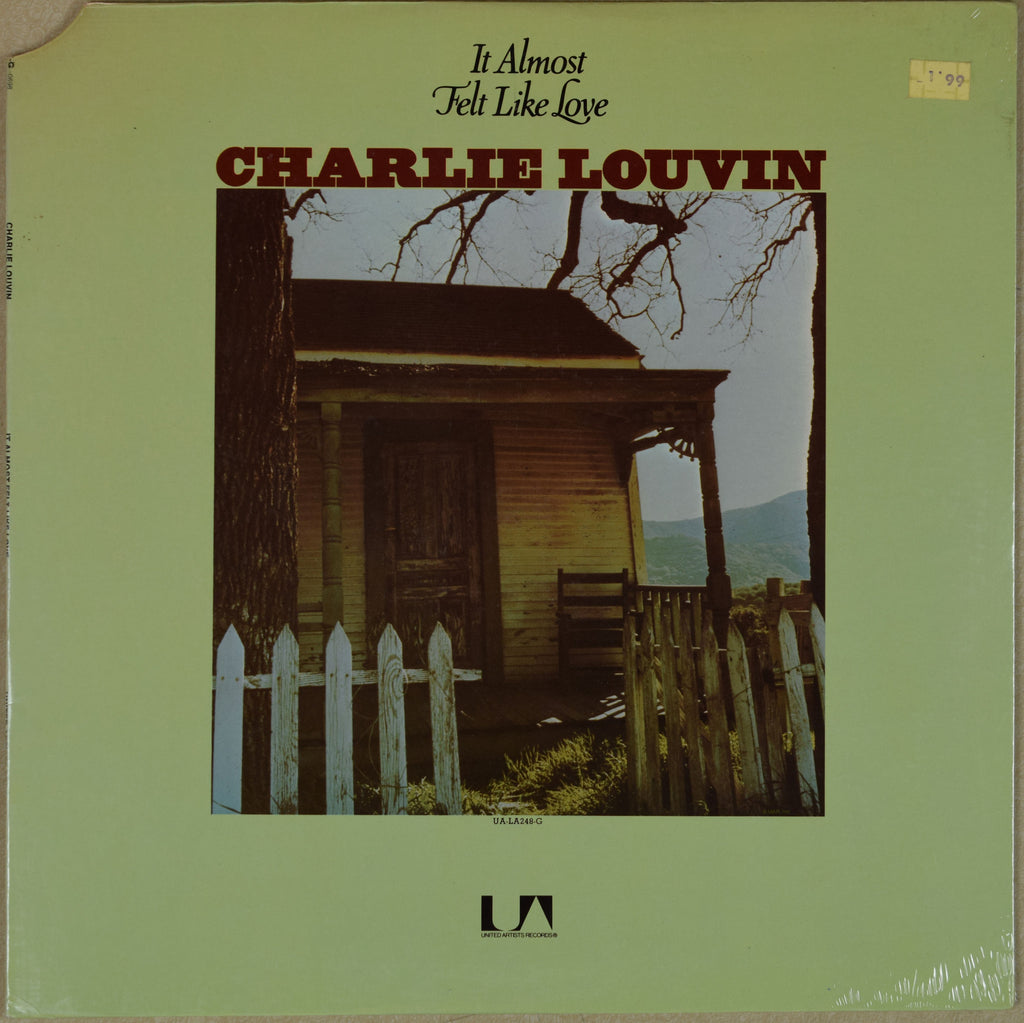 Charlie Louvin / It Almost Felt Like Love
