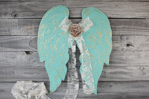 Teal angel wings