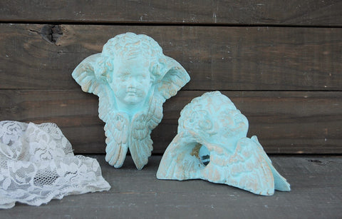 Mint cherub drapery sconces