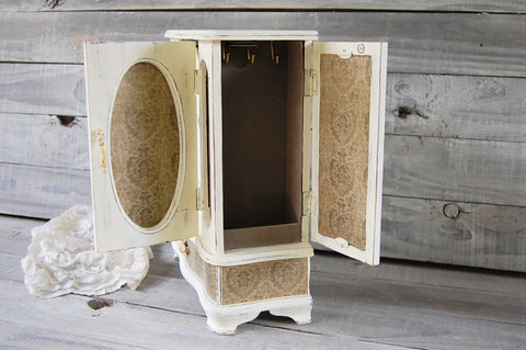 Ivory damask armoire