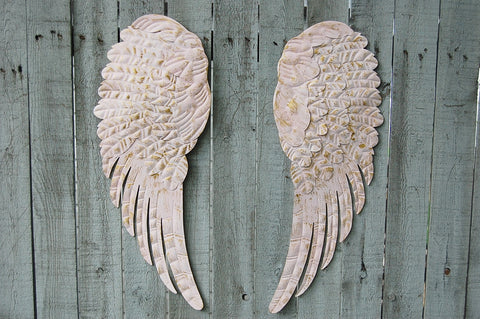 Pink angel wings wall decor