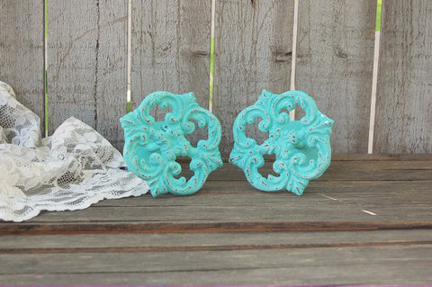 Aqua drapery holders - The Vintage Artistry