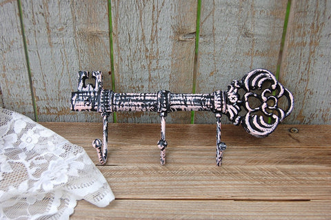 Pink and black cast iron key holder
