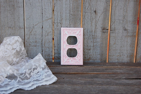 Pink and white double outlet cover