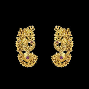 Ethnic Motif Ruby Earrings In Yellow Gold.