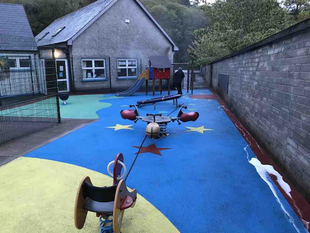 After softwashing children's play area - wet pour safety surface - with Benz Lightning Cleanze