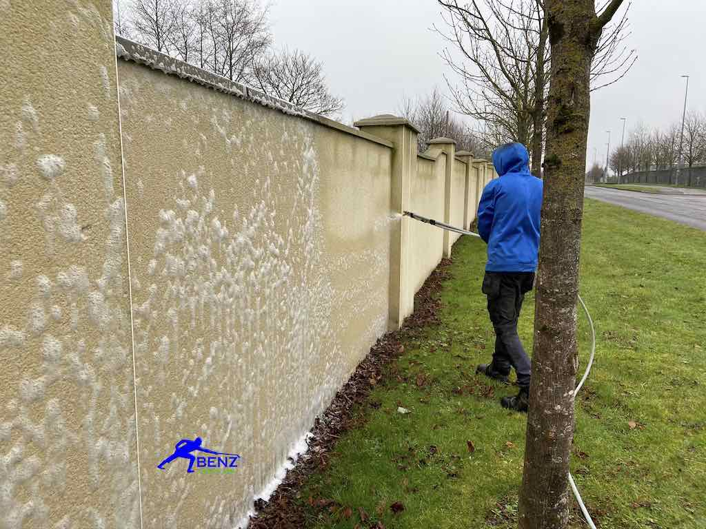 Soft washing a rendered garden wall Benz Softwash Services
