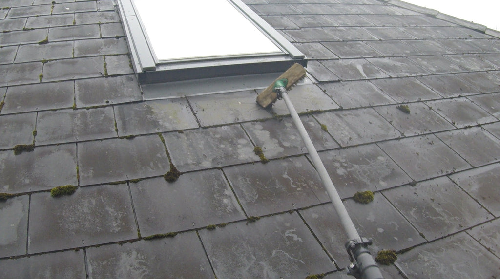 Deck Brush Used To Remove Moss From A Roof