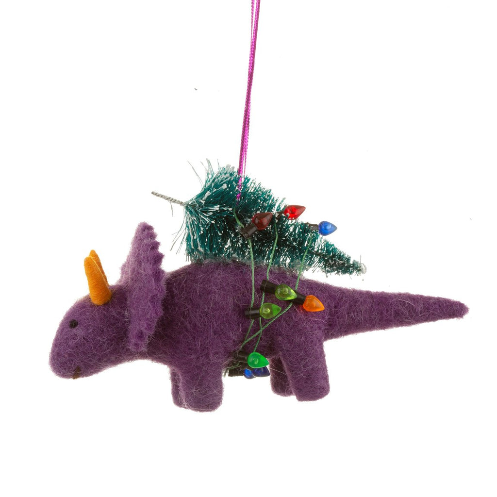 purple triceratops carrying a Christmas tree