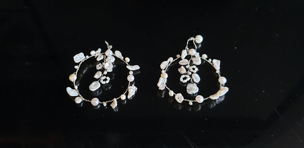 Silver hoop earrings with keshi pearls