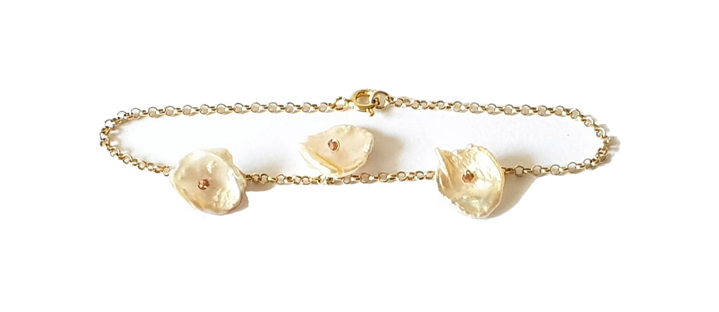 Golden silver bracelet with keshi pearls and red tourmaline