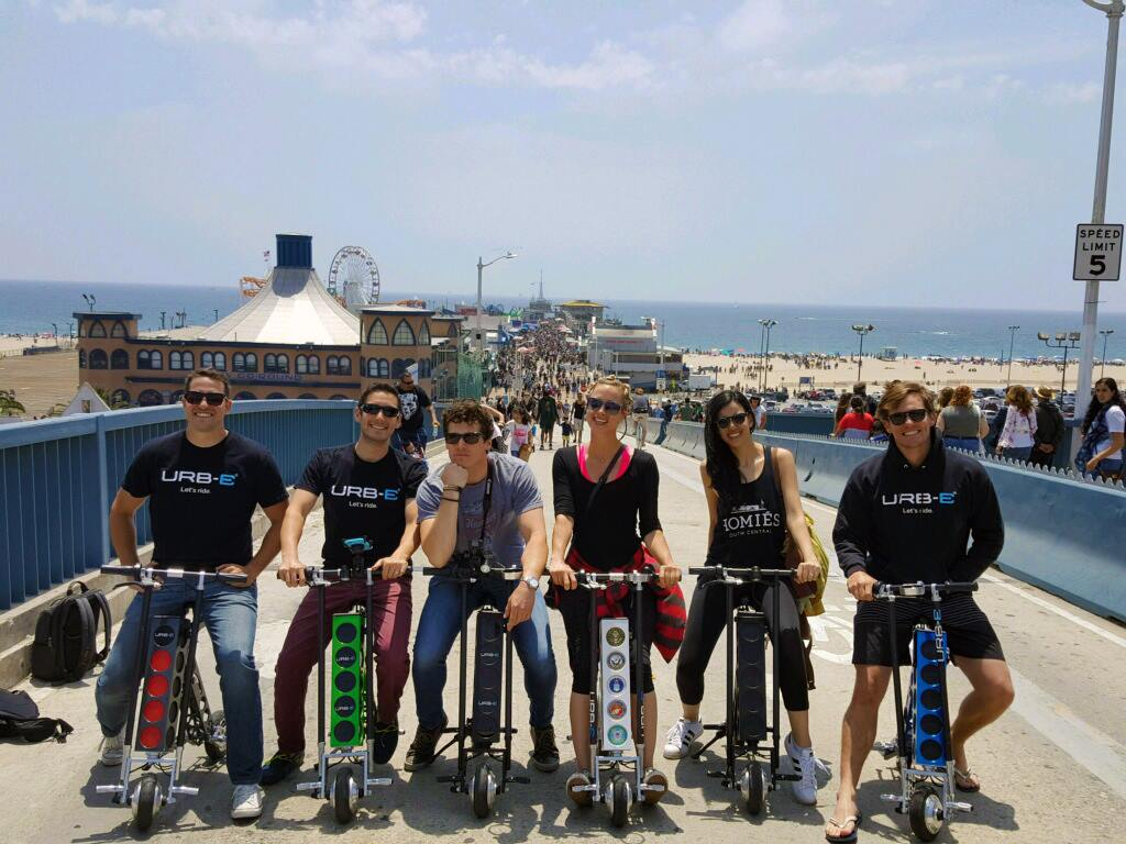 urb-e foldable electric scooters on the santa monica pier in california