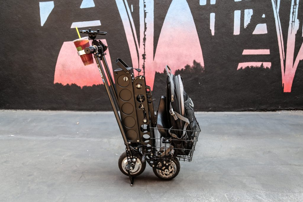 city edition folding e-scooter with seat folds up to go