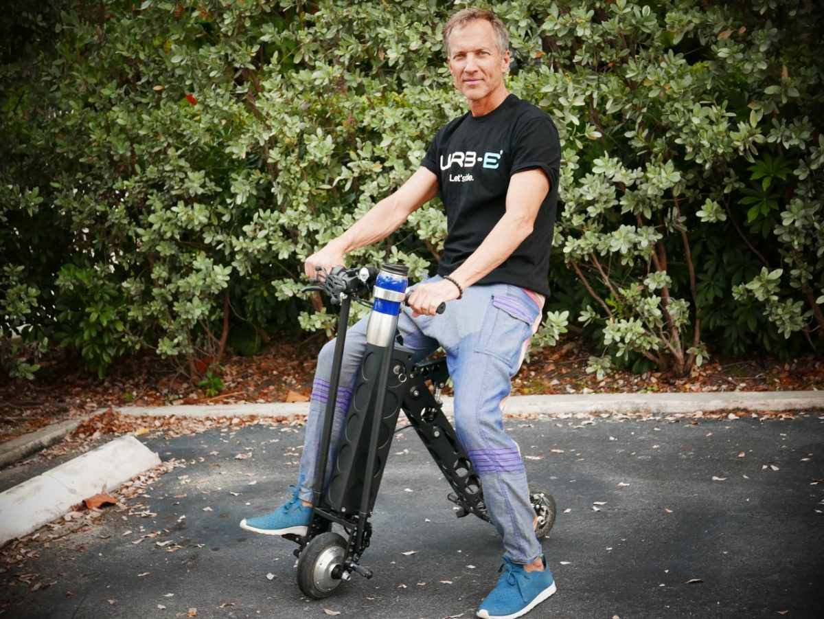 kelly rides urb-e foldable electric scooters in miami beach florida