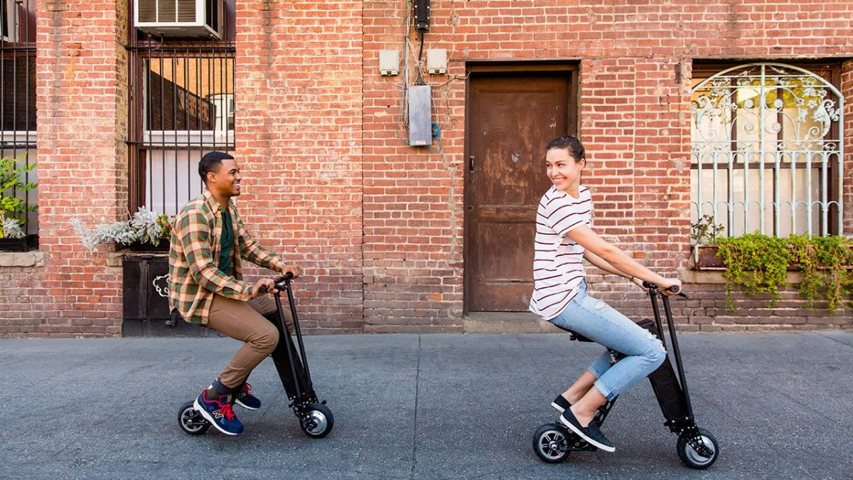 Couple Riding URB-E Black Label foldable electric scooters in pasadena ca 91106