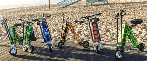 URB-E foldable electric scooters on the beach in Santa Monica California