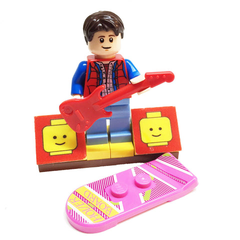 MinifigurePacks: Lego Back to the Future Bundle (1) Marty McFly Minifigure - Cuusoo Variant (1) Figure Display Base (2) Figure Accessory's (Hover Board - Electric Guitar)