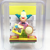 MinifigurePacks: Lego Simpsons Bundle (1) Krusty the Clown Minifigure (1) Figure Display Base (2) Figure Accessory's (Custard Pie - 'The Itchy & Scratchy Show' Decorative Tile)