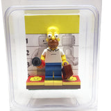 MinifigurePacks: Lego Simpsons Bundle (1) Homer Simpson Minifigure (1) Figure Display Base (2) Figure Accessory's (Buzz Soda Can - Briefcase)