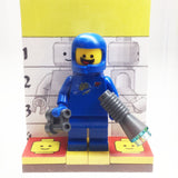 MinifigurePacks: Lego Movie Bundle (1) Benny Minifigure (1) Figure Display Base (3) Figure Accessory's (Oxygen Tanks - Binoculars - Vintage Space Gun)