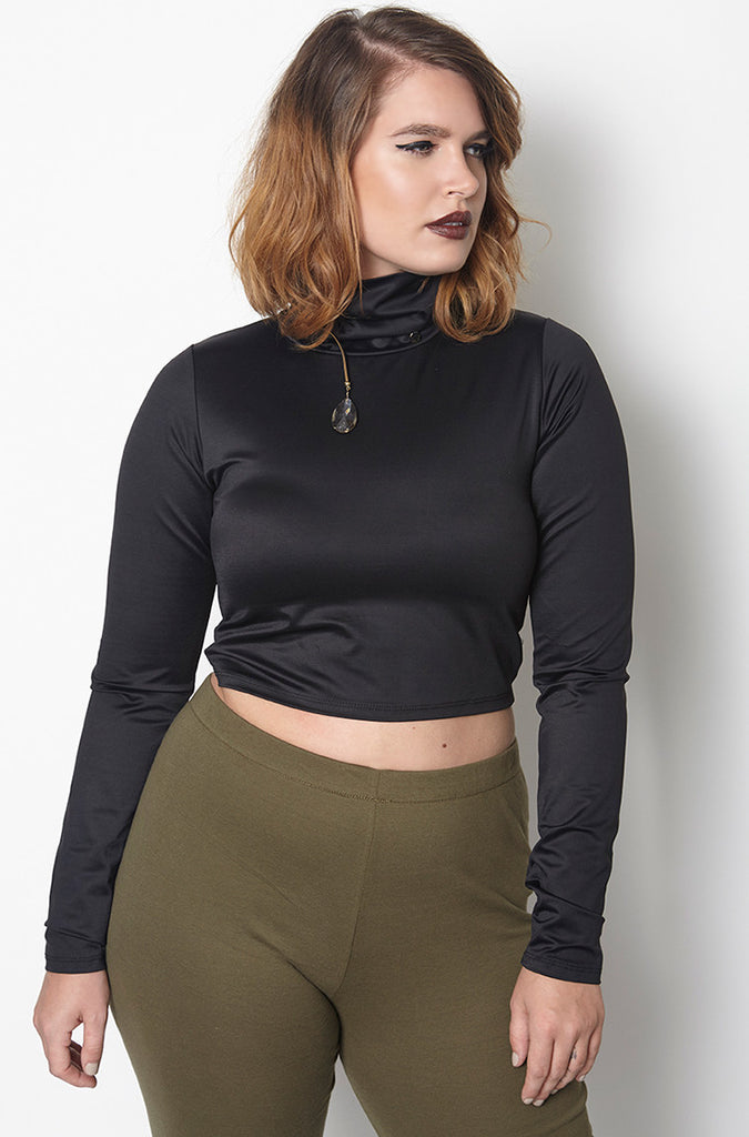 designed with punto milano jersey, this long sleeve top features a turtleneck, cropped styling and shaping seams.