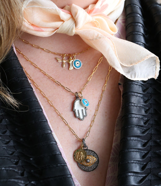 necklace layers with spiritual charms