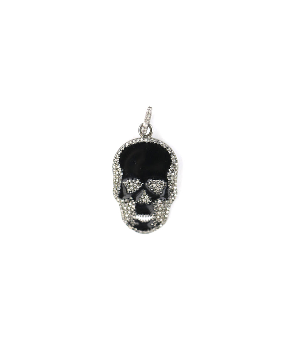 We are obsessed with these diamond skull charms! Add some edge to you #neckmess. Shop more skull jewelry at j-landa.com.