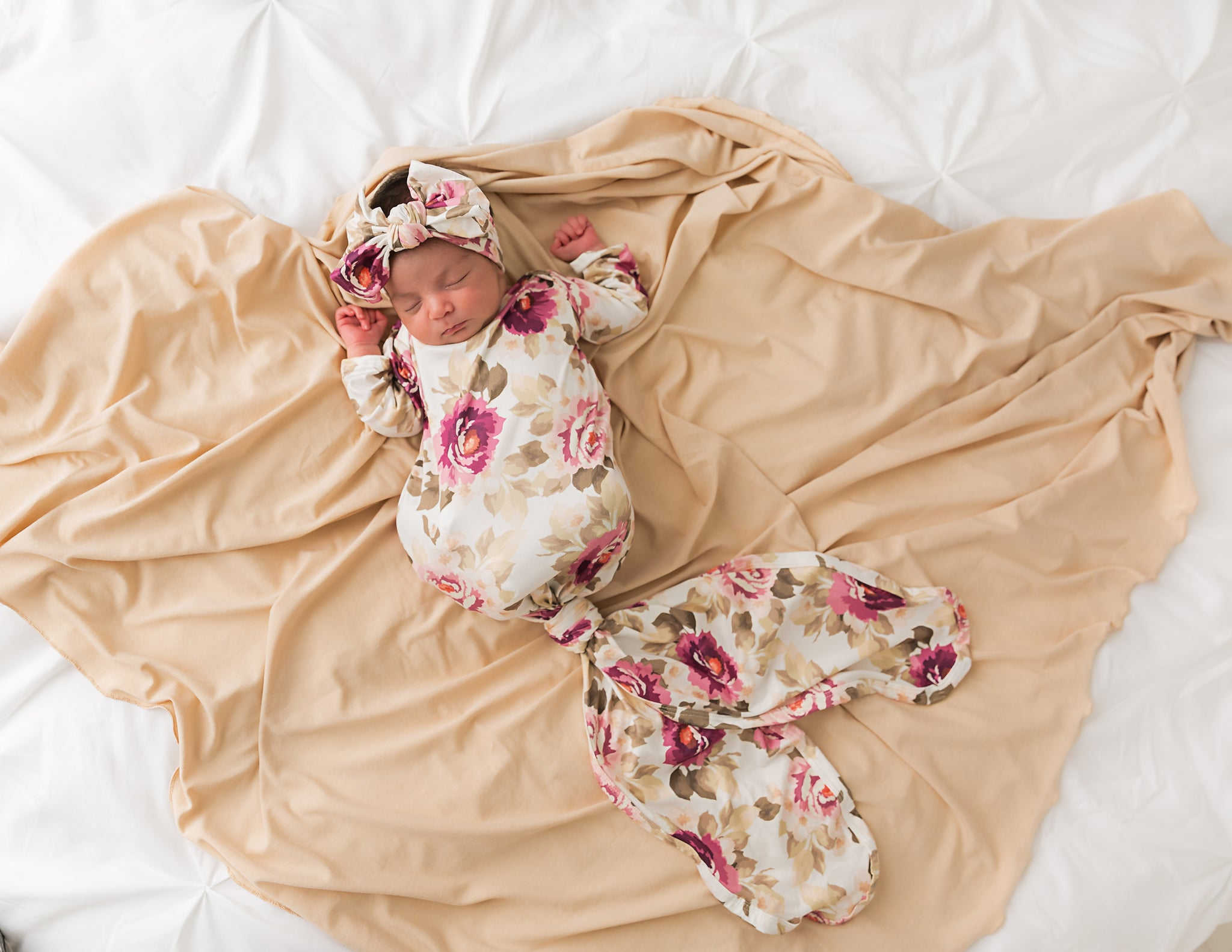 sleeping baby in swaddle blanket set