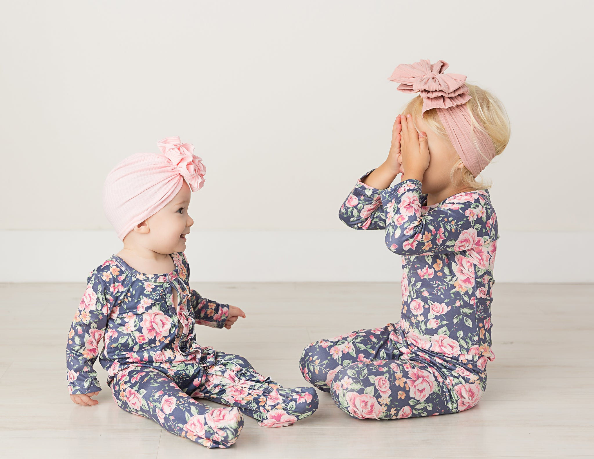 toddler and baby in blue floral two piece set