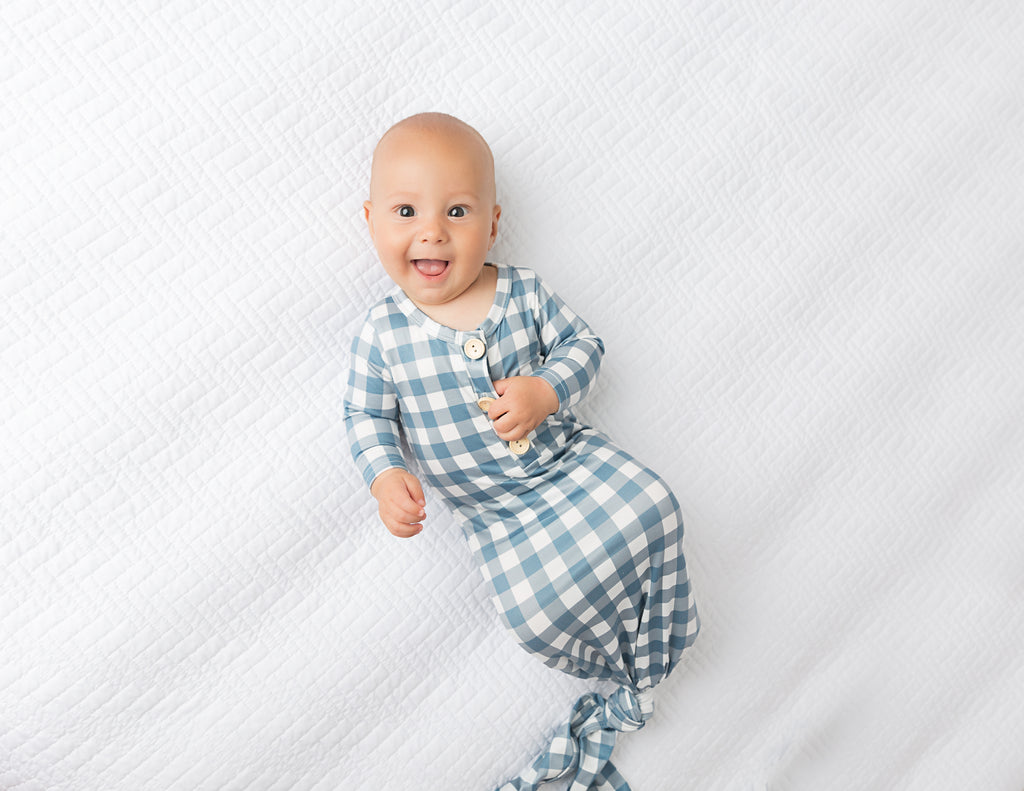 cute baby boy in blue gingham knotted gown