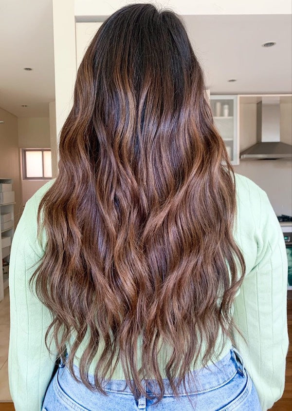 woman donning The THICK Halo in Col. Dark + Medium Brown #2/4 halo hair extensions