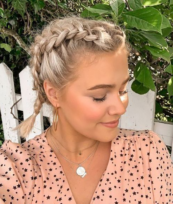 short hair blonde girl with french braids wearing an oily hairstyle