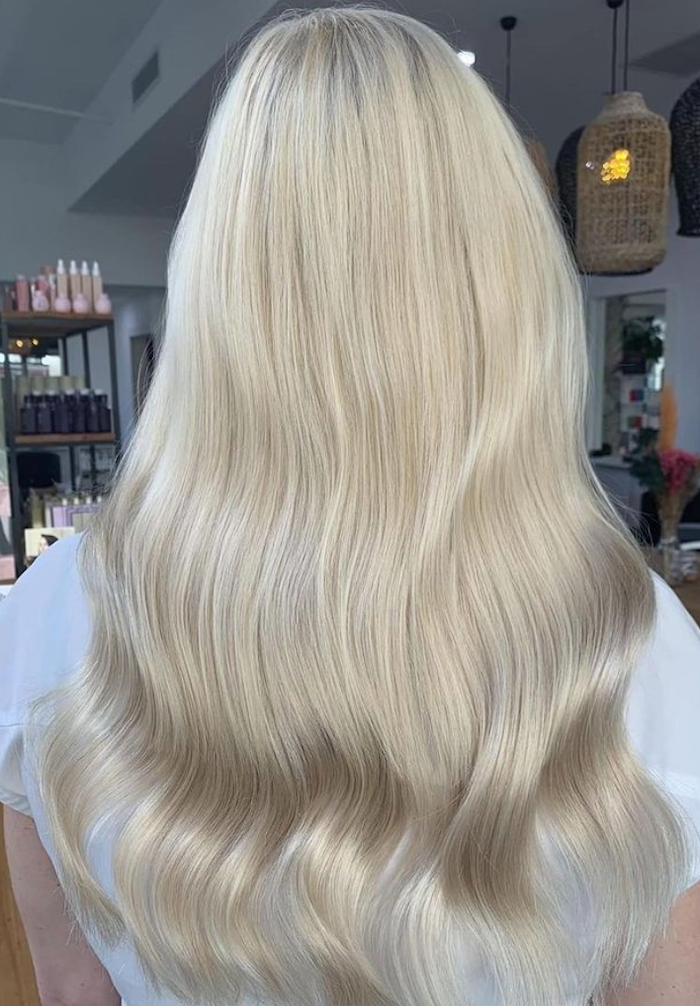woman donning The Medium Halo in Col. #20C Cream Blonde halo hair extensions