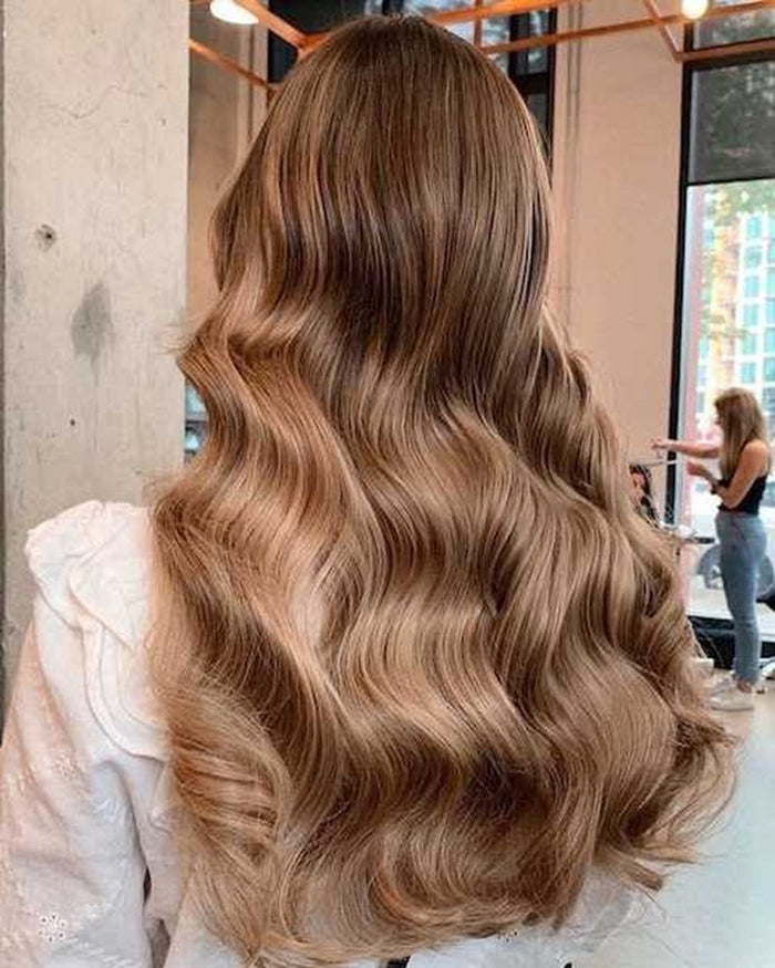 Wearing THICK Halo in col. Dark Blonde #10 halo hair extension for long blonde hair after using a natural scalp treatment for hair growth