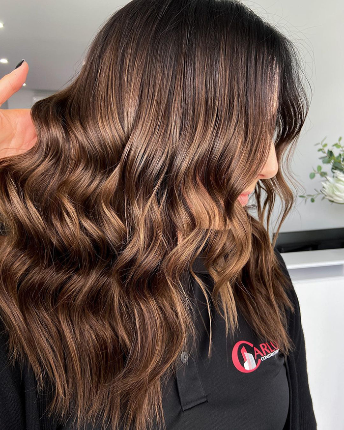 woman with sitting pretty halo hair extensions asking are scalp scrubs bad