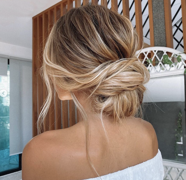 Christmas party hairstyles low messy bun halo hair extensions