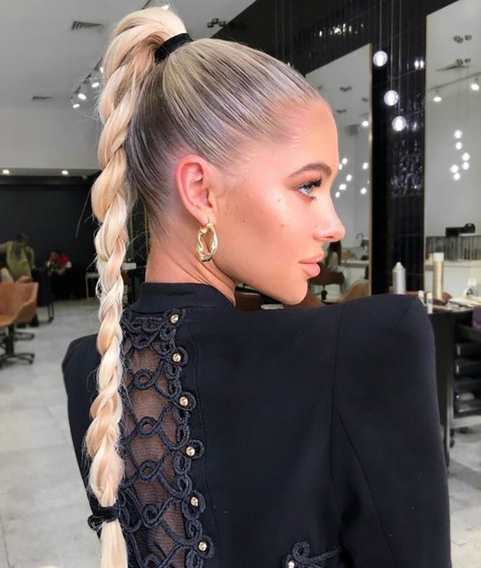 blonde girl with very oily hair wears hairstyle in high braided ponytail