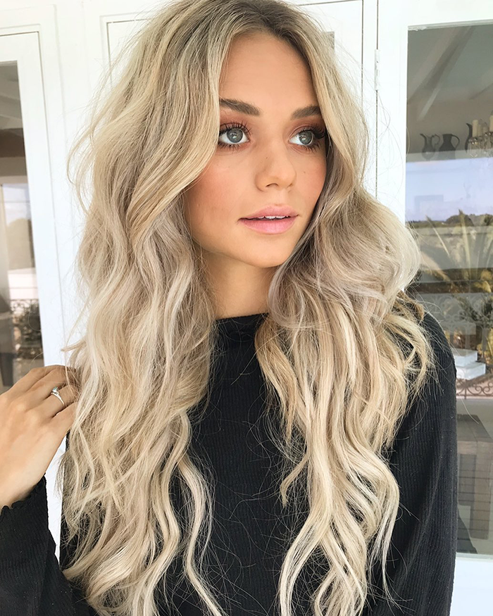 girl with blonde halo hair extensions wondering what does hydrate hair mean