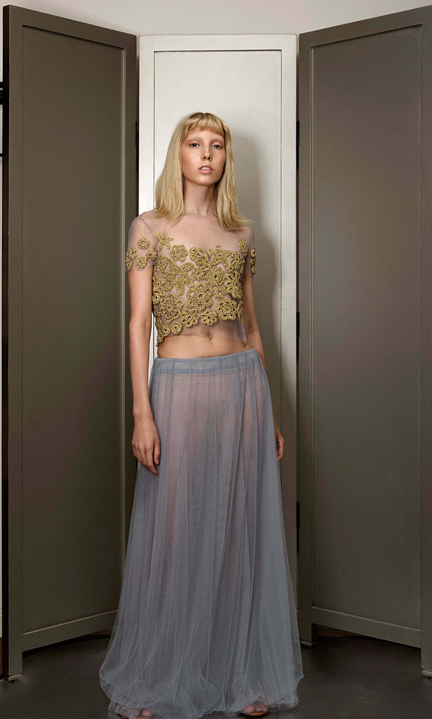 Top with handknitted golden appliation with a tuille skirt