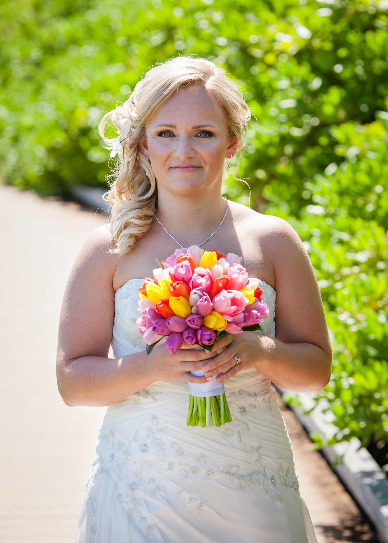 Bride poses with Bouquet in Maui, Hawaii