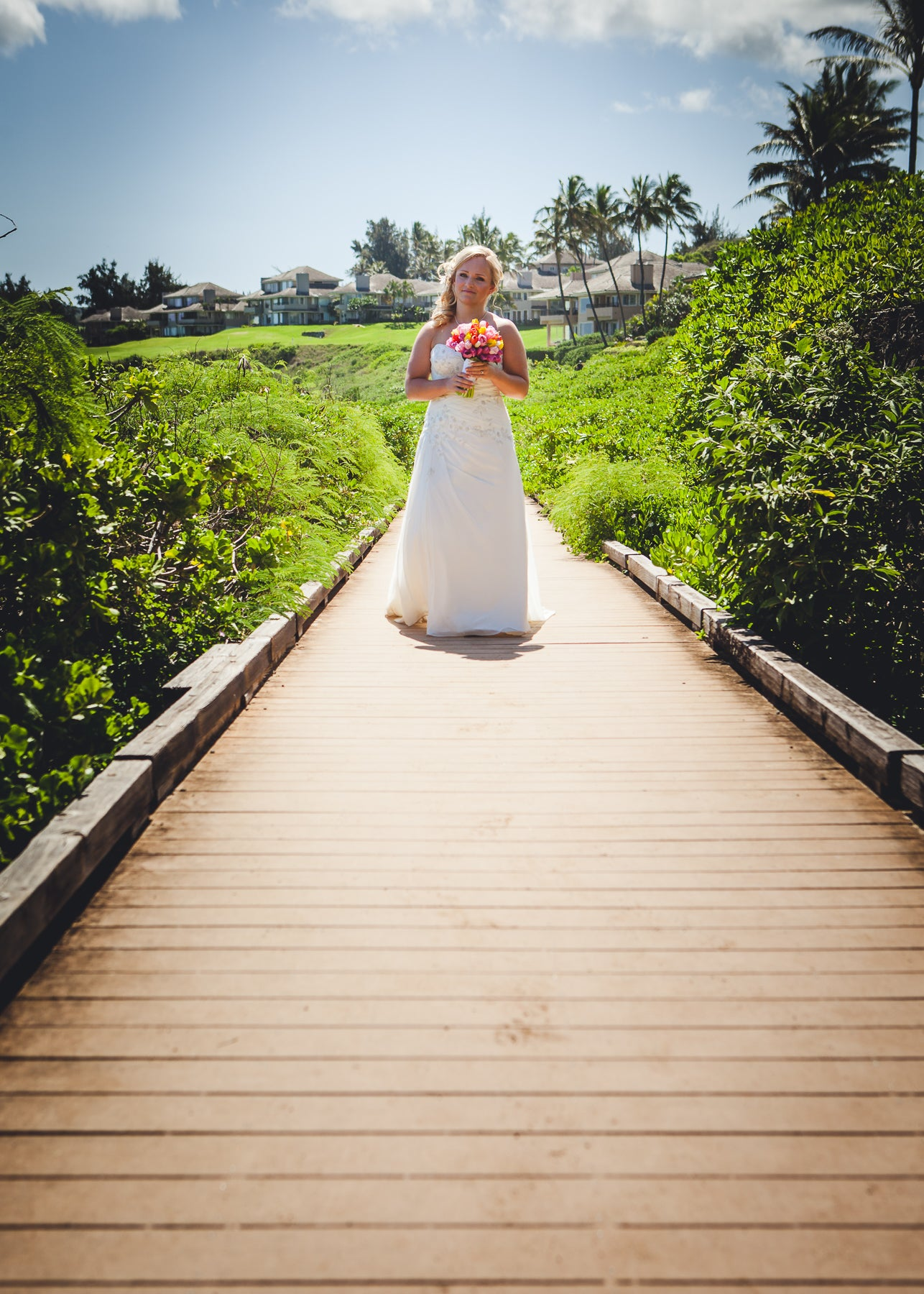 Brides walks along walkway in Maui, Hawaii