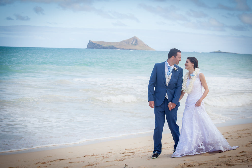 Bride and Groom walk on Waimanalo Beach, Oahu