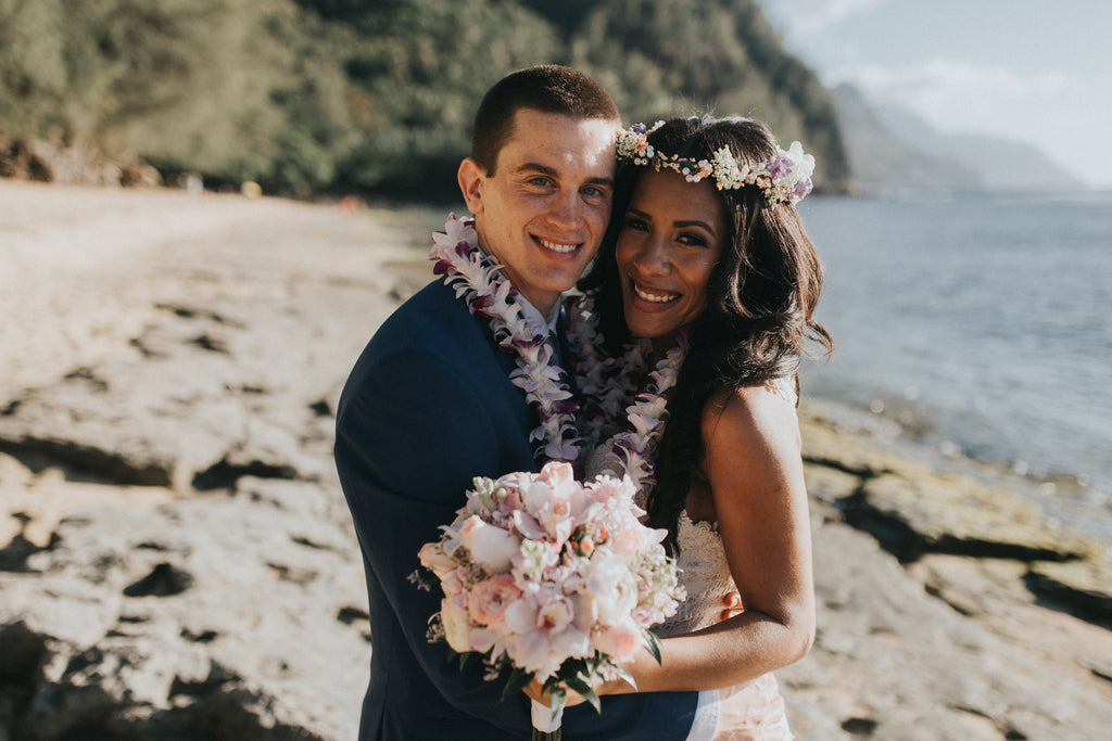Bride and Groom smile at Ke'e Beach