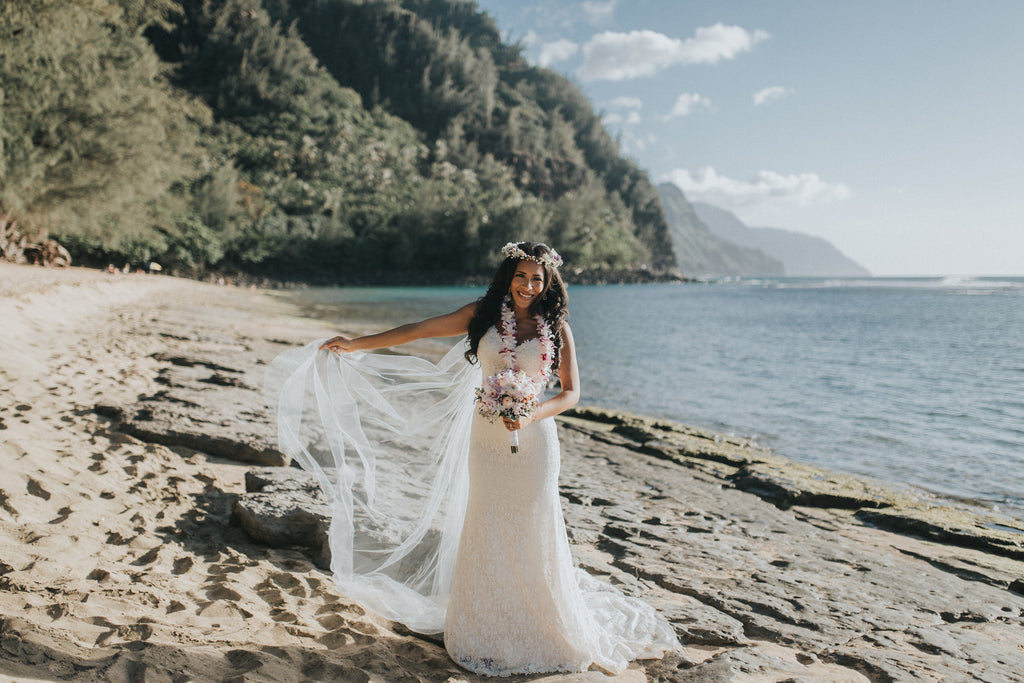 Bride poses with her dress in Kauai