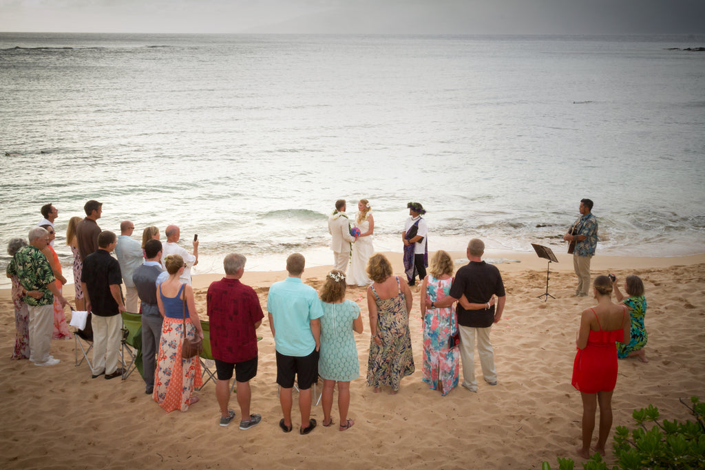 Bride and Groom surrounded by Friends and Family on Beach in Maui, Hawaii