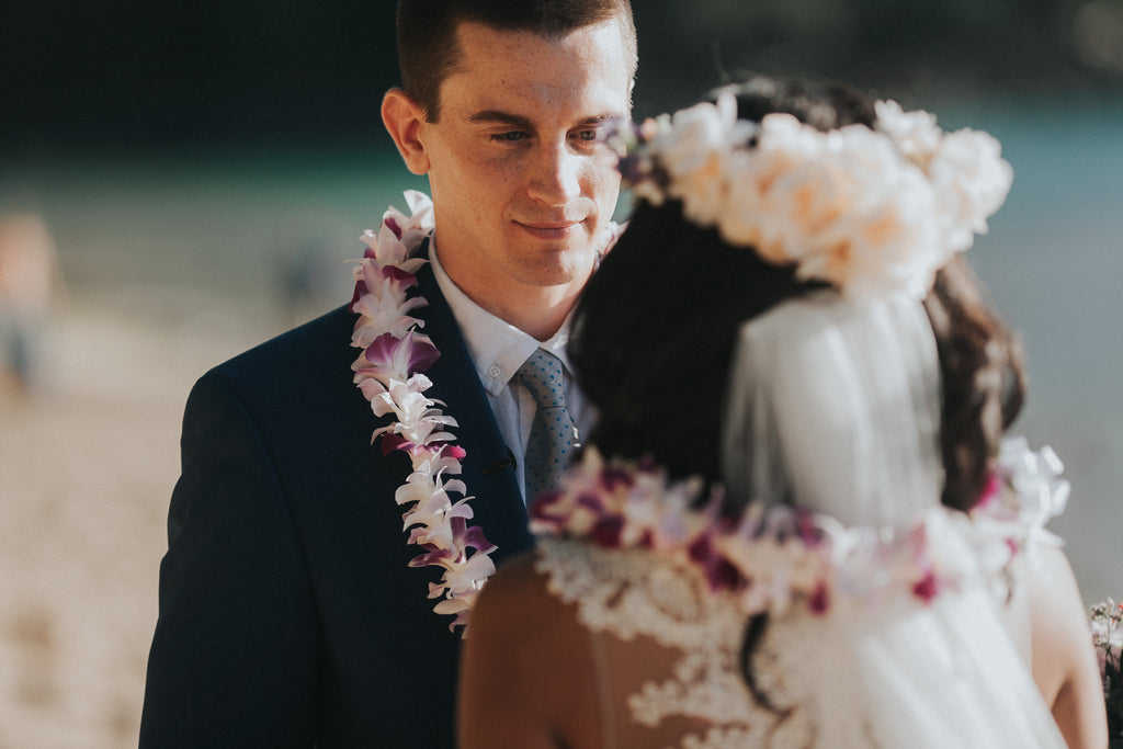 Groom looks at his Bride during Wedding at Ke'e Beach in Kauai