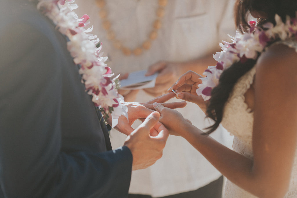 Exchange of Rings as Bride and Groom Marry at Ke'e Beach in Kauai